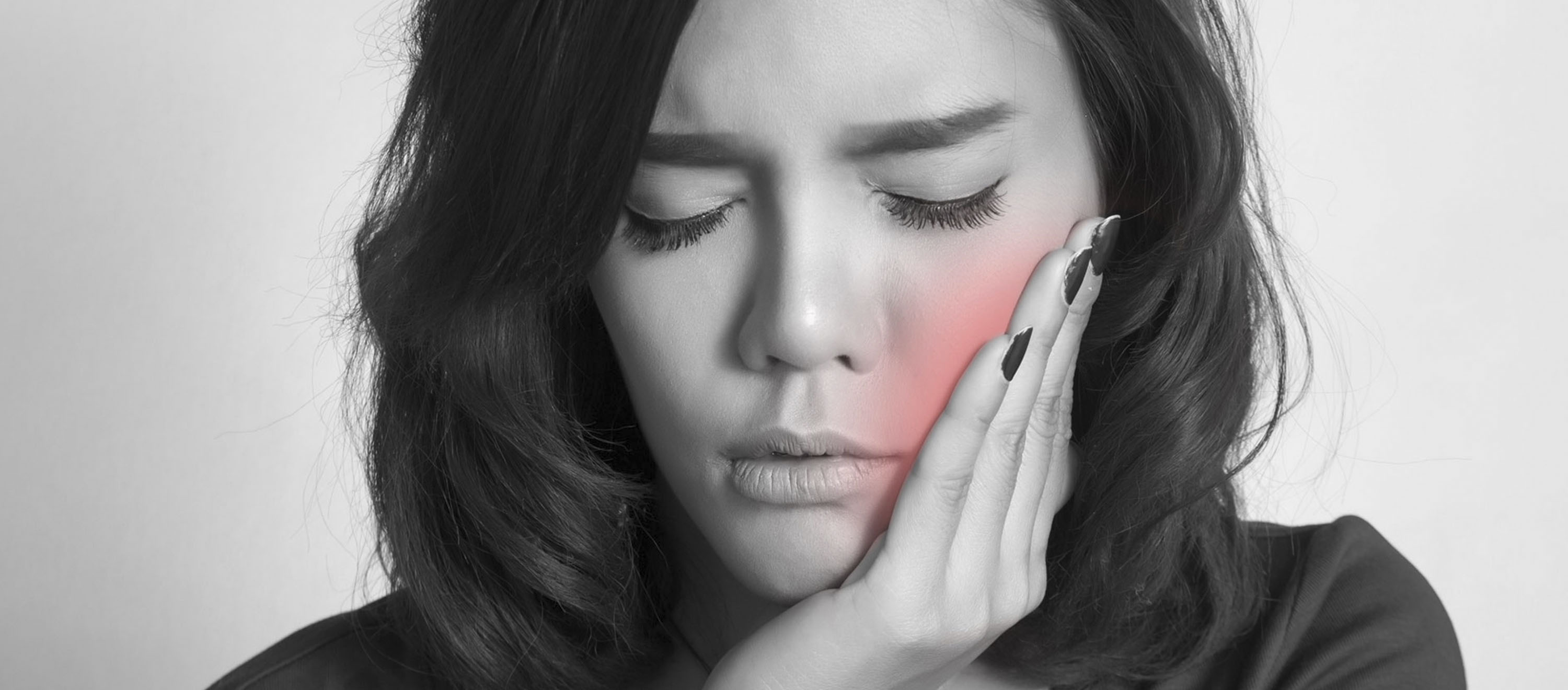 Wisdom tooth, pain A pretty young woman has severe pain in her wisdom tooth.