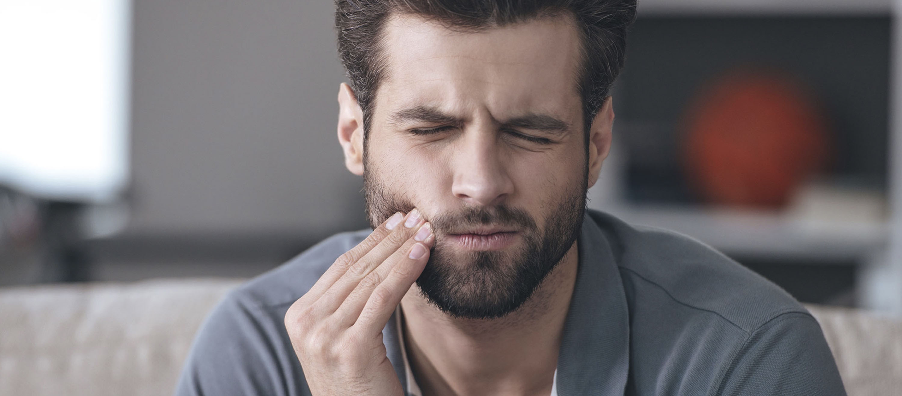 A man has pain in his tooth due to a cyst.