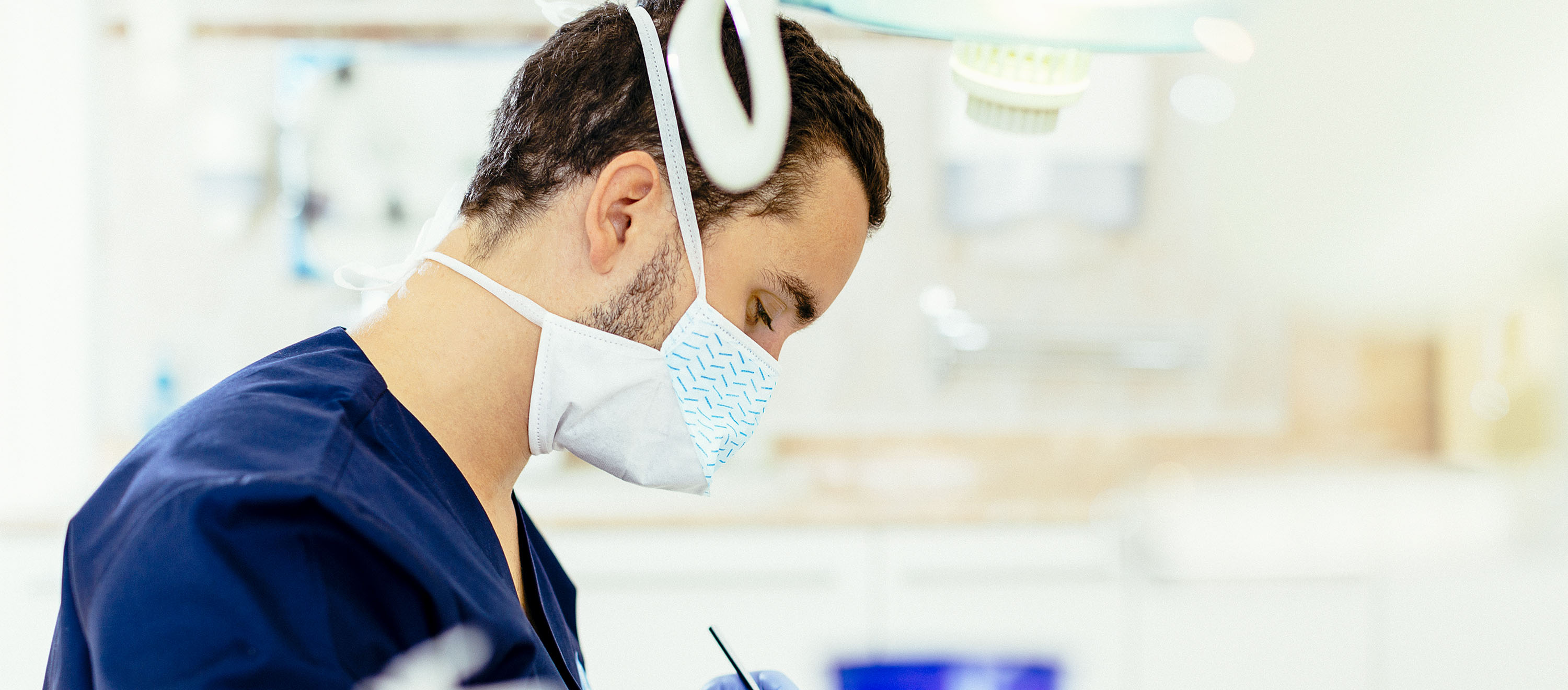 A dental surgeon completes tooth removal at ArtDent dental clinic